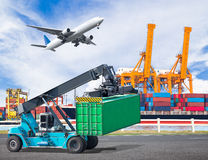 Crane lifts a container to commercial delivery cargo container. Truck in an industrial harbor and cargo plane flying above ship port for logistic import export stock photos