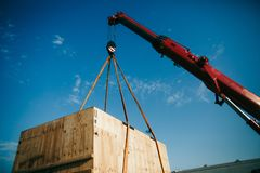 Crane lifts heavy container on a truck royalty free stock photo