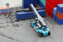 Crane lifts large weight container Stock Photos