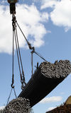 Crane lifts and moves a pack with metal reinforcement Stock Photography