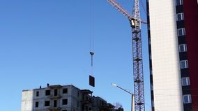 Crane lifts panel block stock video footage