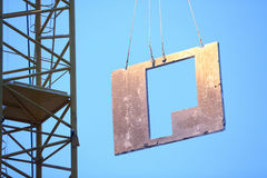A crane lifts the plate to build a house Royalty Free Stock Photography