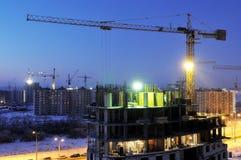 Crane loader at night construction stock images