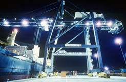 Crane loading container ship at night Stock Photo
