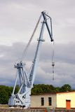 The crane for loading of freights on the ships Stock Photos