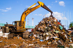 Crane-Loading scrap in a truck royalty free stock photos