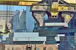 Crane loading sheet steel Stock Photo