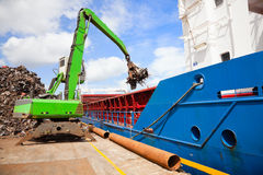 Crane Loading ship with steel stock image