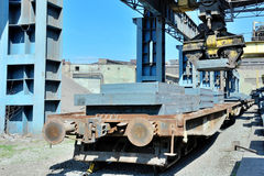 Crane loading steel stack Royalty Free Stock Photography
