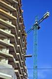 Crane located near block of flats Stock Photography