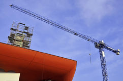 Crane located near block of flats under construction Royalty Free Stock Image
