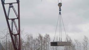 Crane lowers concrete slab stock video