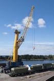 Crane makes loading in the port  Royalty Free Stock Photo