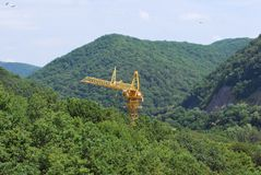 Crane middle mountains Royalty Free Stock Image