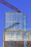 Crane with mirror glass skyscraper Royalty Free Stock Photography