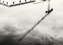 Crane is mirroring in water, black and white Royalty Free Stock Images