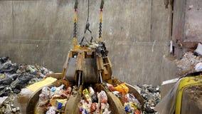 Crane moving piles of garbage stock footage