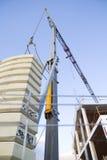 Crane near building on blue sky stock image