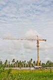 Crane near building on Cloudy sky background Royalty Free Stock Photography