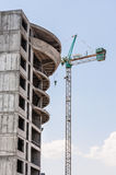 Crane near concrete building Stock Image