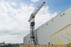 Crane near a covered dry dock Royalty Free Stock Image