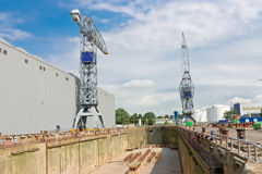 Crane near a covered dry dock Stock Photography