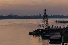 Crane near river of Bangkok Thailand Stock Photo