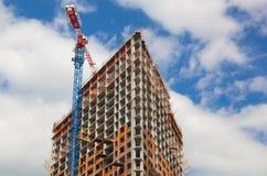 Crane near a skyscraper under construction Stock Photos