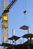 The crane and new building. The elevating crane on construction of a new building Stock Photos