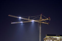 Crane At Night. A construction crane downtown at night Royalty Free Stock Images