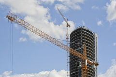 Crane with office buildings royalty free stock photo