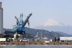 Crane at an oil mill with mt. Fuji Stock Image
