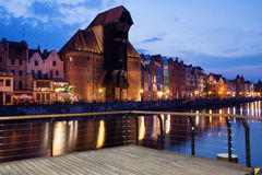 The Crane and Old Town of Gdansk at Dusk Stock Images