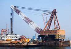 A crane operates to build the bridge to Macau and Zhuhai Royalty Free Stock Photo