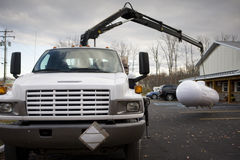 Crane in operation. Lifting a large gas tank royalty free stock photography