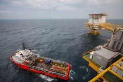 Crane operation with supply boat, cargo transfer. Stock Photo