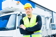 Crane operator in front of truck on site Royalty Free Stock Image