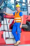 Crane operator standing on company yard Royalty Free Stock Photos