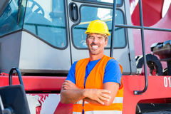 Crane operator standing proud on company yard Royalty Free Stock Images