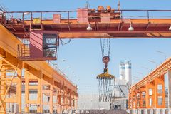 Crane operator working at finished goods warehouse Royalty Free Stock Images