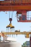 Crane operator works at finished goods warehouse Royalty Free Stock Image