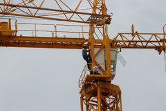 Crane Operators changing shift high above the ground stock images