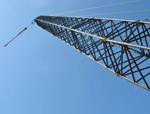 Crane opposite a blue sky Stock Image
