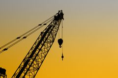 Crane with orange sky in evening royalty free stock photo