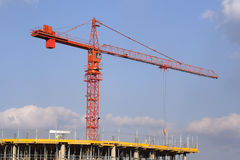 Crane over building site. Construction crane in place over new building royalty free stock photo
