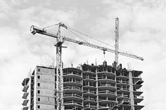 Crane over building under construction Stock Photo