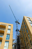 Crane over the buildings. Royalty Free Stock Image