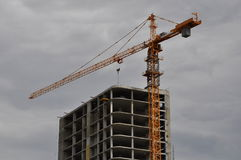 Crane over constructed skyscraper Royalty Free Stock Photo