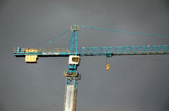 Crane over the grey sky Royalty Free Stock Photo