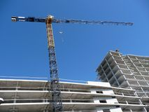 Crane over modern building Royalty Free Stock Photos